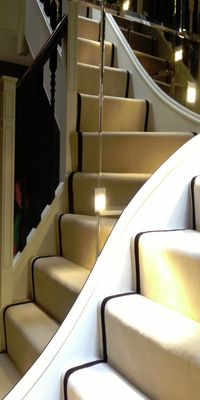 An example image of mirrors on a stairwell produced and installed by Hamilton Glass Products Ltd