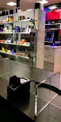 An example image of a glass safety screen in a shop.